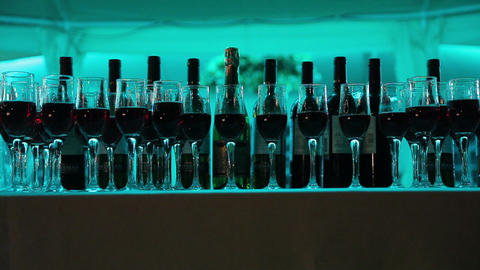 Still life with wine bottles, glasses and oak barrels Footage
