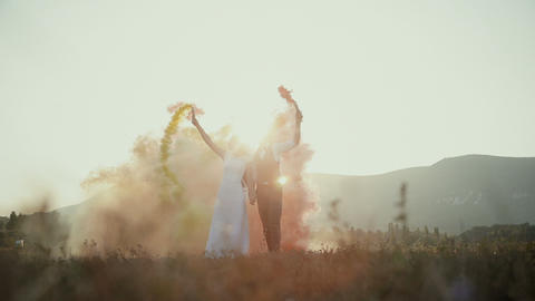Bride and groom with smoke bombs Footage