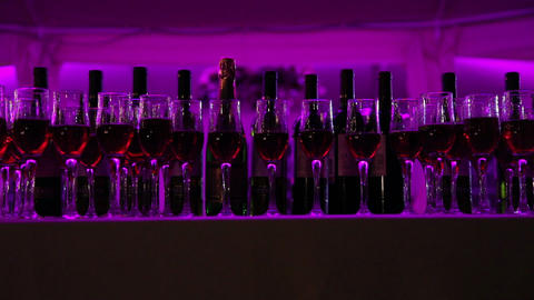 A number of wine bottles and glasses on a wedding cocktail party Footage