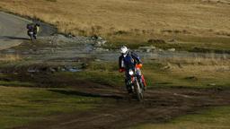 Biker climb speed a road of land 117b Footage