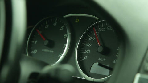 the dashboard of the car in motion Live Action