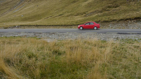 Follow the red car that runs on the road 103 Footage