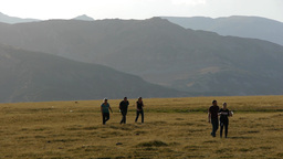 Group of people walking on a mountain meadow 112b Footage