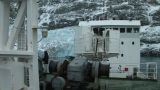 South Georgia: expedition ship passing icebergs and mountain 7 Footage