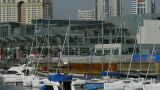 Yacht On Water At Pier Of QingDao City Olympic Sailing Center,tsingtao,Tower,building,skyscraper,arc stock footage