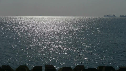 Sparkling water surface and fishing... Stock Video Footage