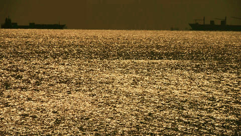 Sparkling water surface and Vessel Ship,horizon,skyline,gold Stock Video Footage