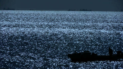 Sparkling water surface and Vessel Ship,horizon,skyline,night.abstract,backgroun Footage