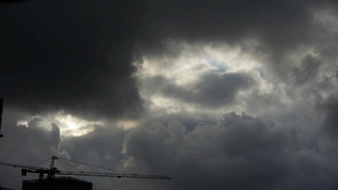 Dark clouds cover sky,Cranes,building high-rise,House... Stock Video Footage