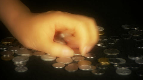 Hand grabbed a lot of money and coins Stock Video Footage