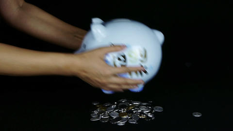 coins falling from Piggy bank in black space Stock Video Footage