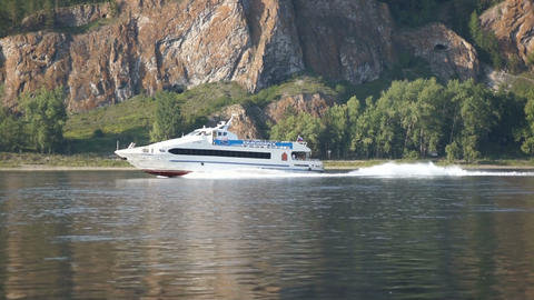 Pleasure boat sails on the river Yenisei Stock Video Footage