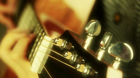 playing guitar,strum,golden sunlight Stock Video Footage