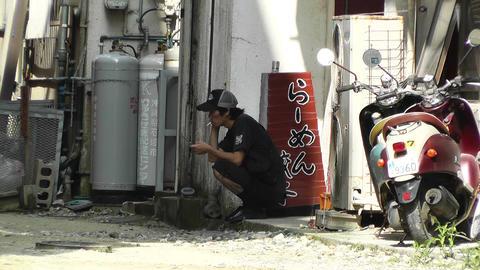 Rural Town Street in Okinawa Islands 16 men taking a break Stock Video Footage