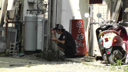 Rural Town Street in Okinawa Islands 16 men taking a break Stock Video Footage