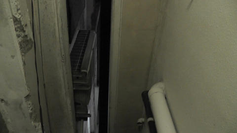 Scary Narrow Alley 01 tilt down Stock Video Footage