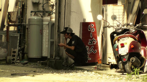 Street in Okinawa Islands stylized 06 man taking a break Stock Video Footage