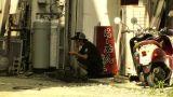 Street in Okinawa Islands stylized 06 man taking a break Footage