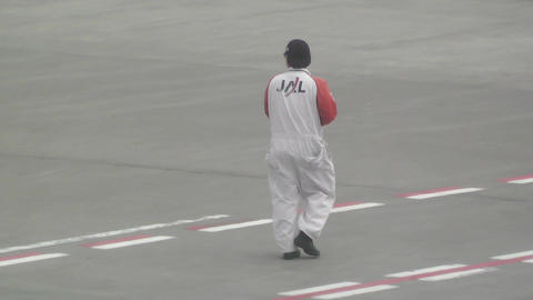 Tokyo Narita Airport worker jal Stock Video Footage