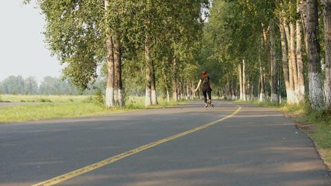 Roller-skating Girl dressed in black Stock Video Footage