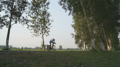Bicyclist is riding in the park Stock Video Footage