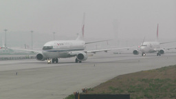 Beijing Capital International Airport 25 on the runway waiting line handheld Footage