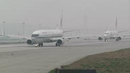 Beijing Capital International Airport 25 on the runway waiting line handheld Footage