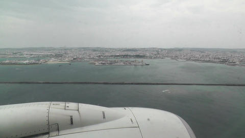 Okinawa City view from Airplane 01 handheld Stock Video Footage