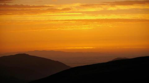 Orange sunrise over the mountains 141 Footage