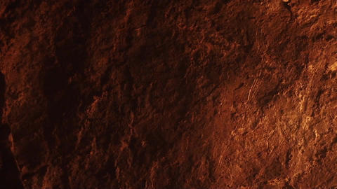 A Torch Flame Projected Over A Stone Wall In A Dark Cave 756 stock footage