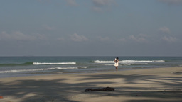 Ngwe Saung, woman looking for shells on the beach Footage