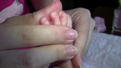 Mother massaging fingers from the little girls foot 01 Footage