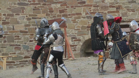 2542 Knights in armor fighting in the fortress on the axes Footage