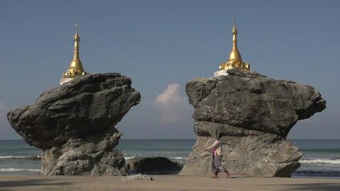 Ngwe Saung, Woman walking next to the Kyauk Maumghnama Pagoda Footage