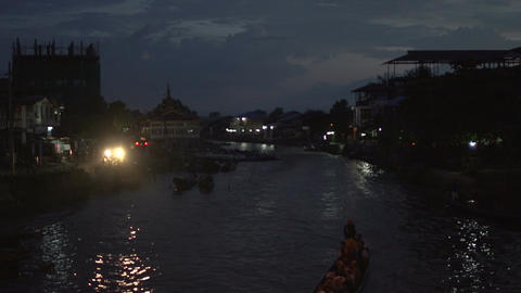 Nyaung Shwe, longboats floating in the harber at night Footage