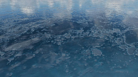 Flight over frozen water surface Close-up Footage