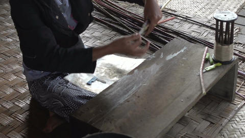 Nyaung Shwe, woman makes silk from bamboo sticks Footage