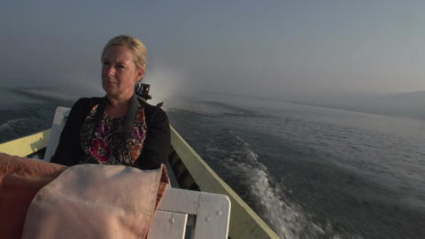 Nyaung Shwe, blond woman in boat on Inle lake Live Action