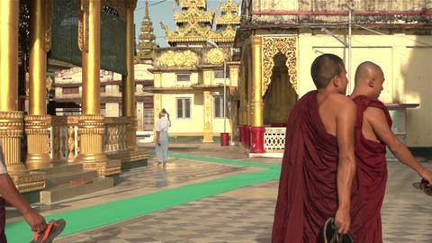 Pathein, A monk walks past at Shwemokehtaw Pagoda Footage