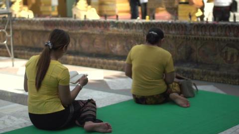 Shwedagon Pagoda, woman praying Live Action