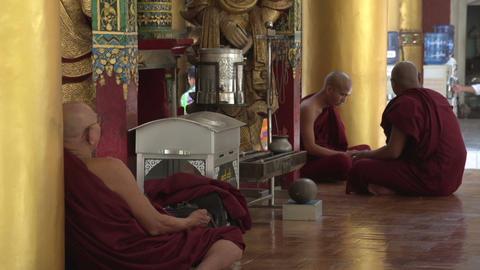 Shwedagon Pagoda, monks praying Live Action