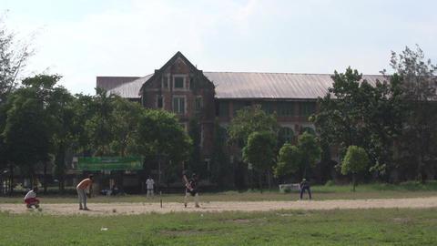 Yangon, playing softball on grassfield Footage
