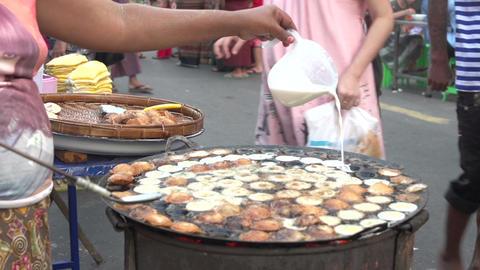 Yangon, baking cakes at street fair Footage