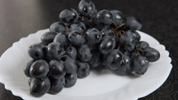 Blue Bunch Of Grapes Lying On A Platter stock footage