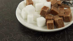 A Set Of White And Brown Sugar On A Plate, A Slow Panorama stock footage