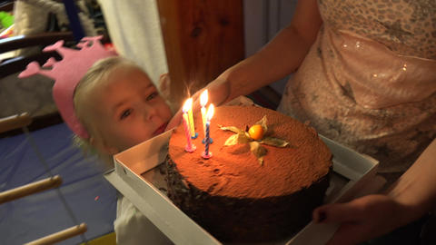 Funny Little Girl Birthday Cake. Blowing Candels. 4K UltraHD, UHD Filmmaterial