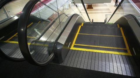 Escalator Top Entrance Handheld Footage