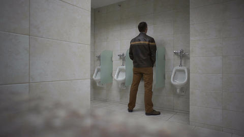 Public Bathroom Man Uses Urinal Live Action