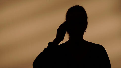 Female silhouette calling on the phone Footage