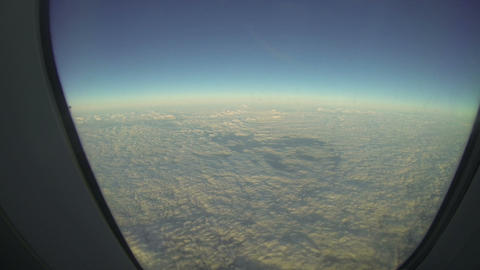 Clouds Through An Airplane Window stock footage